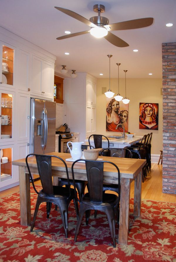 A 1980's-inspired open kitchen layout with dining tables, pendant lighting, and white shaker cabinetry.