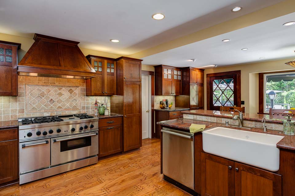 Beau Craftsman Kitchen With Stained, Shaker Wood Cabinetry, Wooden Floors And  Stone Countertops | Source