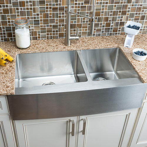 A deep stainless steel sink with two or more bowls will make your life much easier. | Photo Source: Costco