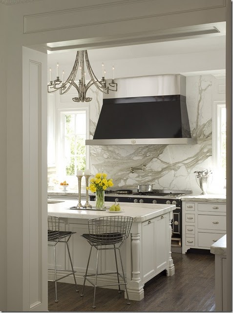 Traditional white kitchen with marble slab backsplash. | Source: Dina Holland Interiors
