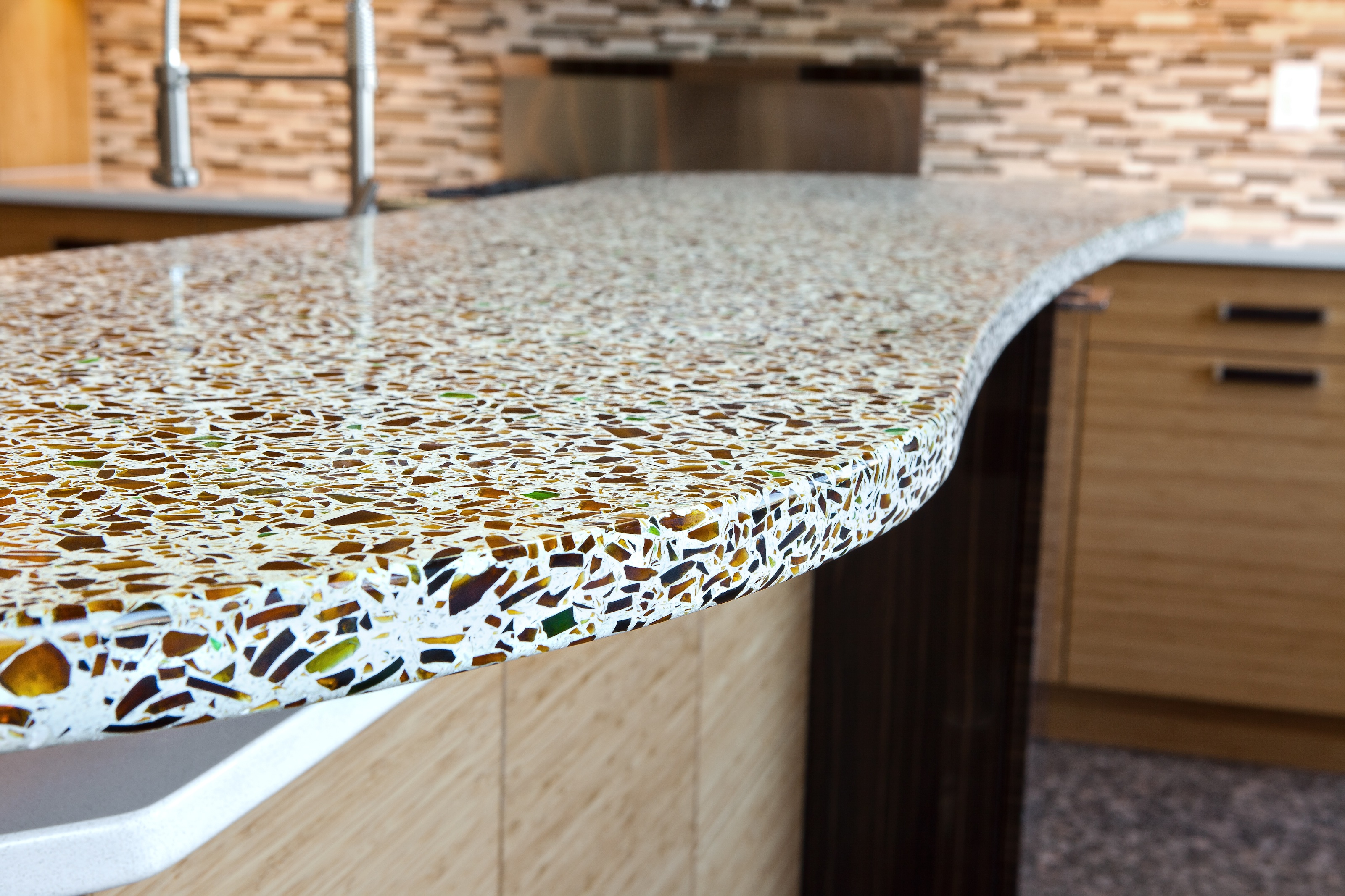 Recycled Glass Kitchen Countertops Recycled glass set in concrete | Photo Source: caddomineral.com