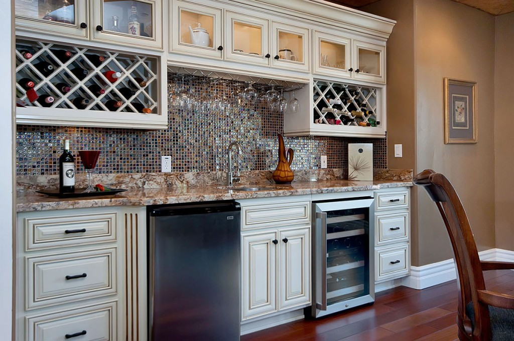 Wet bar with two wine racks and beverage refrigerators. | Photo Source: Marx Design