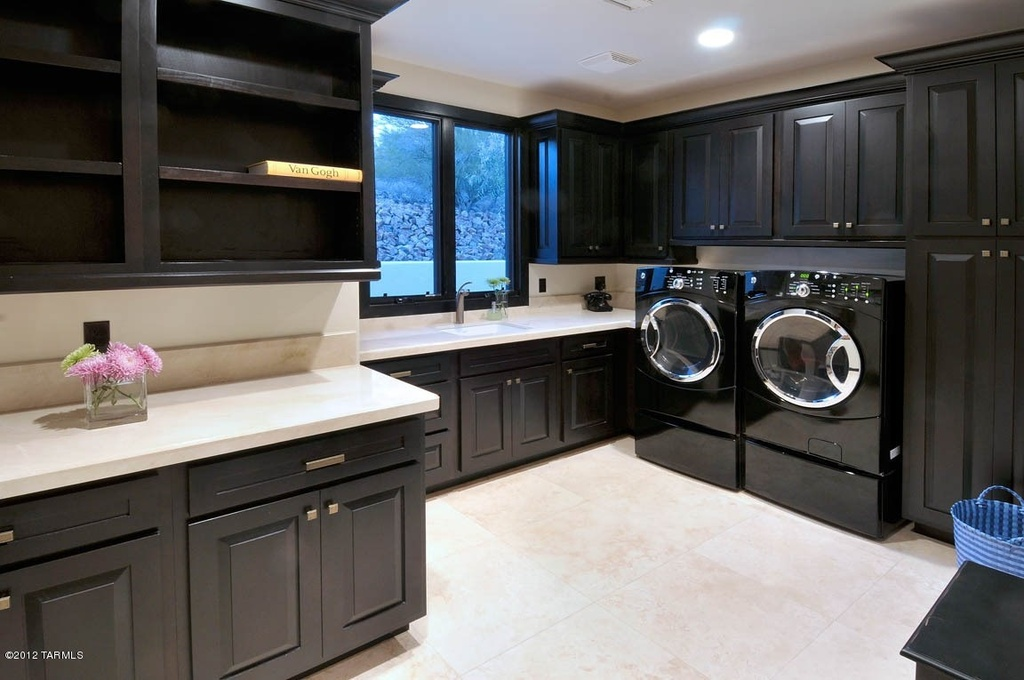 Large Laundry Room With Side By Washer And Dryer Cabinetry Open