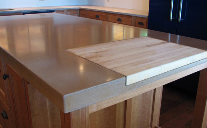 Concrete countertop with wood insert. | Photo Source: designcastconcrete.com