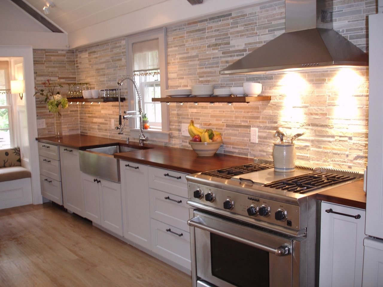 Mahogany Wood Countertop Provides A Warm Contrast To Stainless Steel And White Shaker Kitchen Cabinets