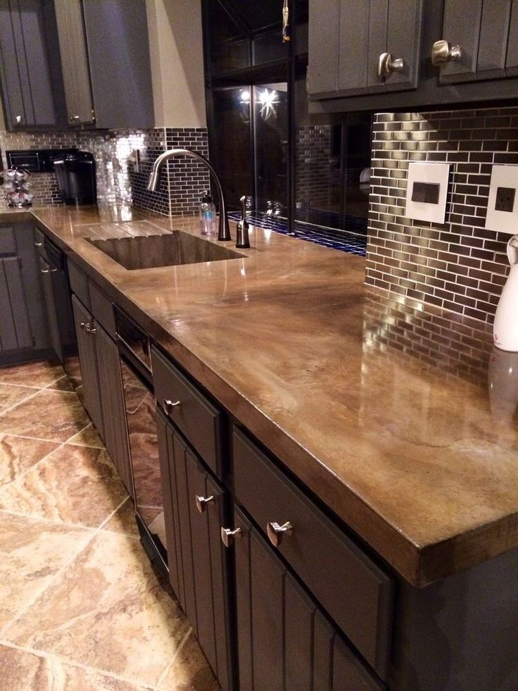 This Sleek Monochromatic Kitchen Utilizes A Concrete Countertop With Design That Perfectly Imitates Natural Stone Such As Granite Countertops